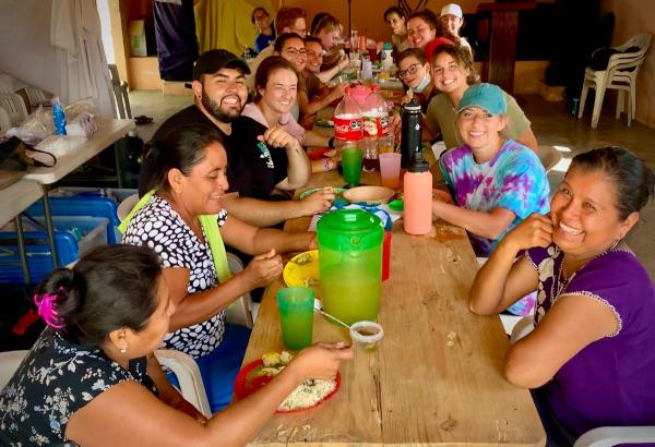 Radiant Team eating in village